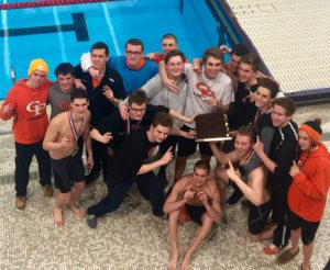 The Prep Swim team celebrates their 14th straight D10 title.